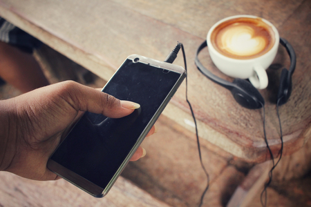 earphone: Selfie of smart phone with earphone and coffee cup
