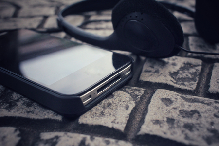 earphone: Earphone with smart phone Stock Photo