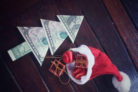 christmas savings: Christmas tree of dollar with gifts