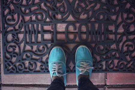 doormat: Selfie of sneakers with welcome doormat