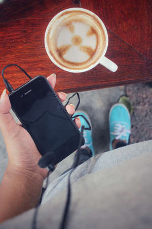 earphone: Selfie of smartphone with earphone and coffee