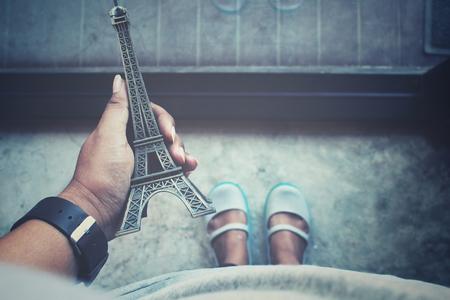 replica: Selfie of hand with eiffel tower replica