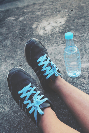 water shoes: Selfie of sport shoes with water drink