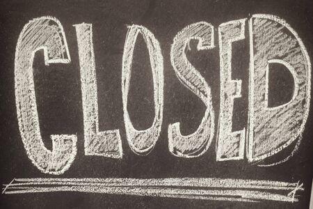 a signboard: Closed signboard