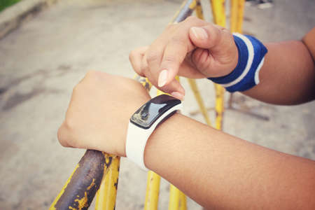 call of nature: Smart watch on hand Stock Photo