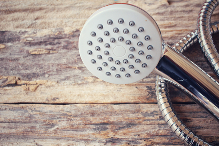 shower head: Shower head on wood background