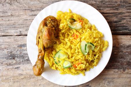 pakistani food: Chicken biryani with rice on wood background