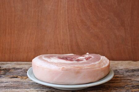 uncooked bacon: Raw pork