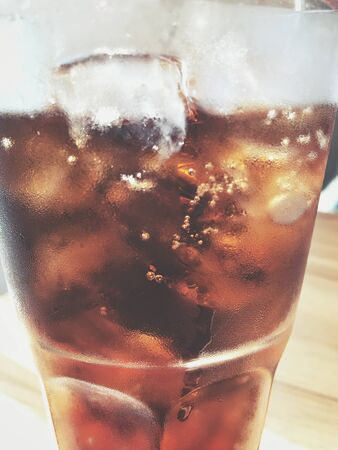 cola: Cola with ice cubes
