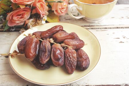 hot date: Dried date palm with hot tea Stock Photo