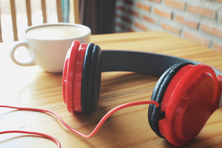 Headphones with latte art coffee