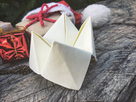 Origami paper fortune teller with christmas decoration Stock Photo