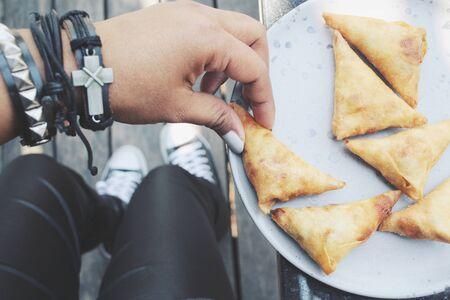 samosa: Selfie of samosa with hand