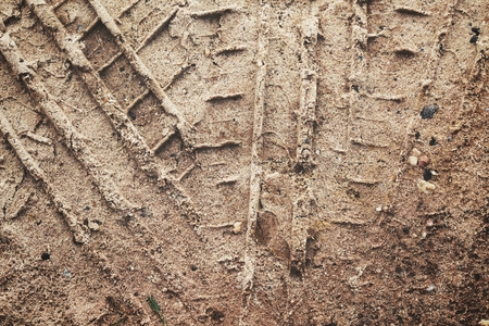 Wheel tracks on the soil Stock Photo - 77997020