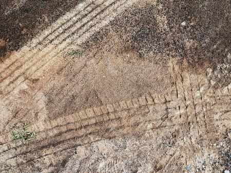 Wheel tracks on the soil Stock Photo - 77929871