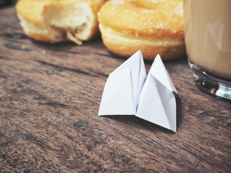Paper fortune teller with coffee and donuts Stock Photo