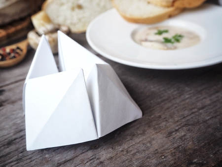 Paper fortune teller with creamy mushroom soup Stock Photo