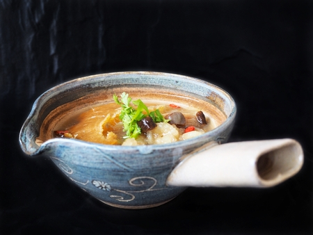 Chinese soup and fish maw with shark fin on black background