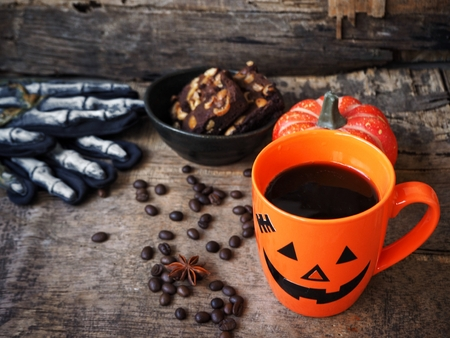 Chocolate brownies cake with black coffee for halloween party Standard-Bild