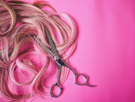 Hair cutting shears on pink background