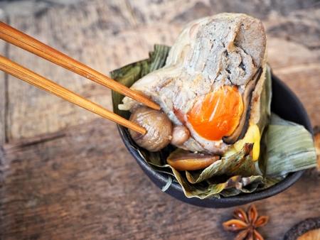 Woman eating zongzi chinese food