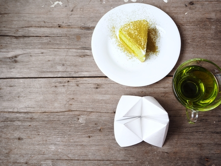 Paper fortune teller and green tea with cake Stock Photo