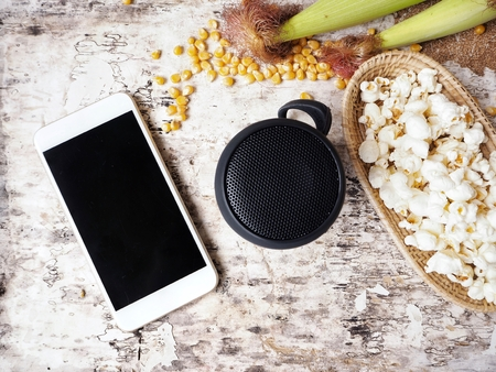 electronic music: Bluetooth speaker with smart phone and popcorn