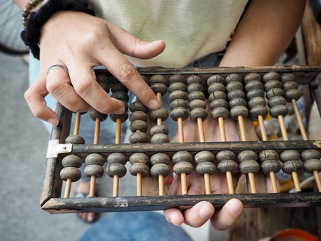 Woman playing abacus