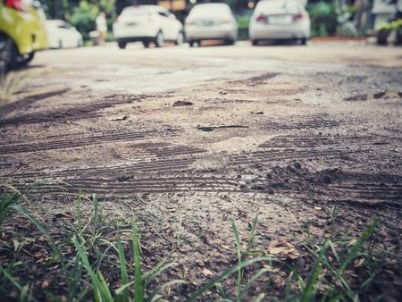 Wheel tracks on the soil Stock Photo - 84558888