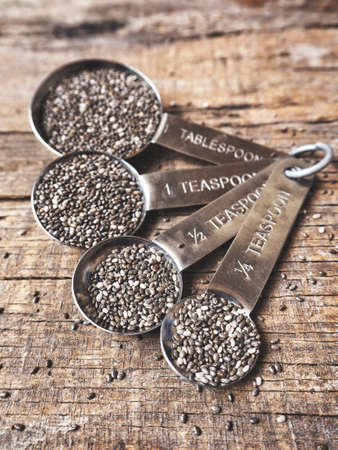 grained: Chia seeds with spoons Stock Photo