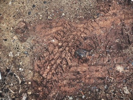 Wheel tracks on the soil Stock Photo - 84883406