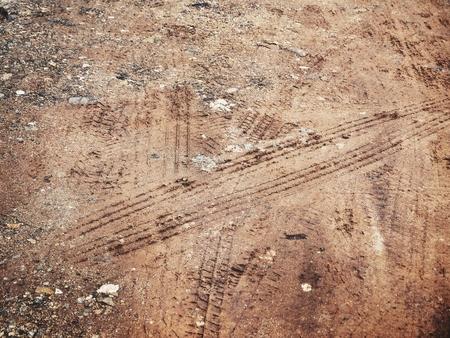 Wheel tracks on the soil Stock Photo - 84886832