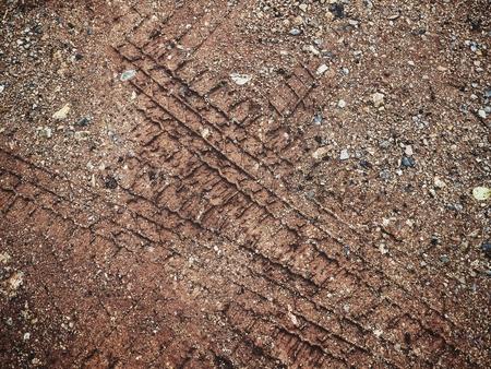 Wheel tracks on the soil Stock Photo