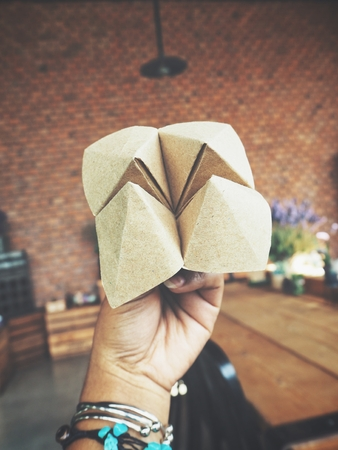Paper fortune teller oh hand