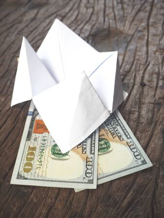 Dollars with paper fortune teller