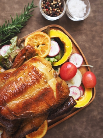 Roasted turkey in thanksgiving on brown background
