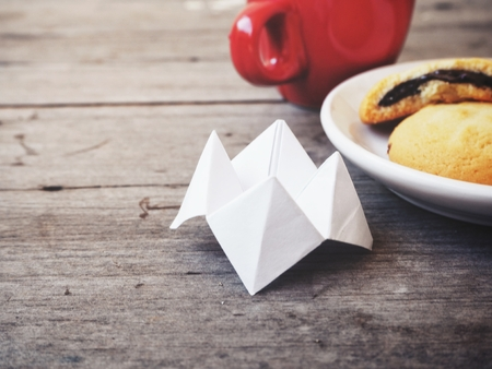 Paper fortune teller with cookie and coffee cup