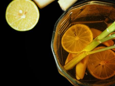 Lemon grass tea on black background