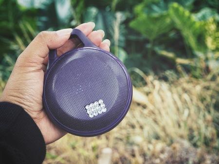 wireless speaker on hand