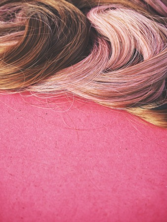 Wig hair on pink background
