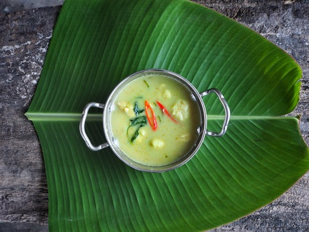Green curry on banana leaves