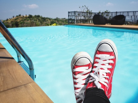 Selfie of red sneakers with swimming pool slifestyle so cool Banco de Imagens