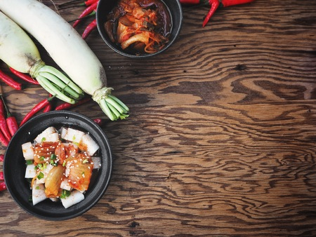 Kimchi radish Korean food background with text space