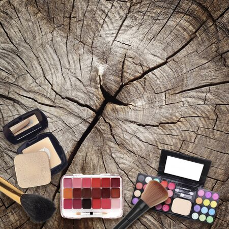 vanity bag: Various makeup products on wooden background