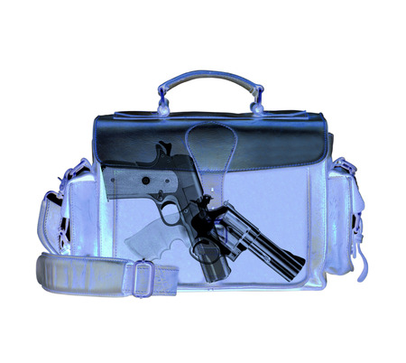 detects: Xray scan detects weapon in criminals briefcase Stock Photo