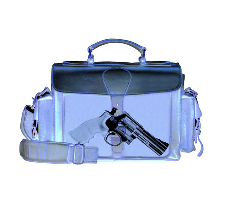 Xray scan detects weapon in criminals briefcase Stock Photo