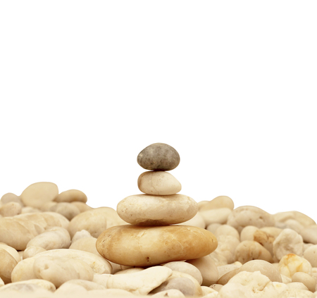 smooth stones: Stack of round smooth stones on a seashore