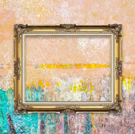 old picture: Old picture frame on grunge wall. Stock Photo