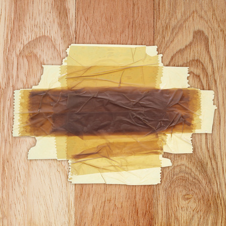 tear duct: Adhesive tape on a wooden background