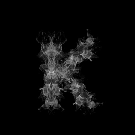 flame letters: Smoke letter K. Stock Photo